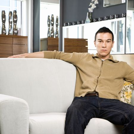 Portrait of an Asian male sitting on couch. Stock Photo - 1874619