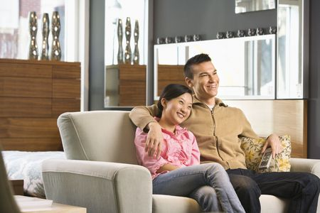 Asian couple watching television. Stock Photo - 1874660