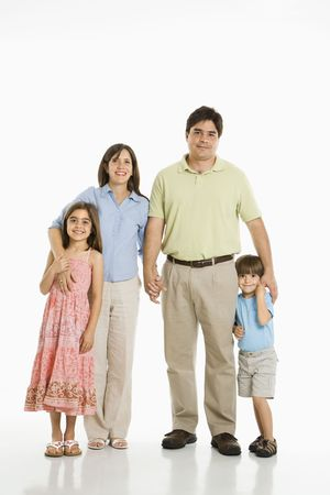 Hispanic family of four standing against white background. Stock Photo - 1874379