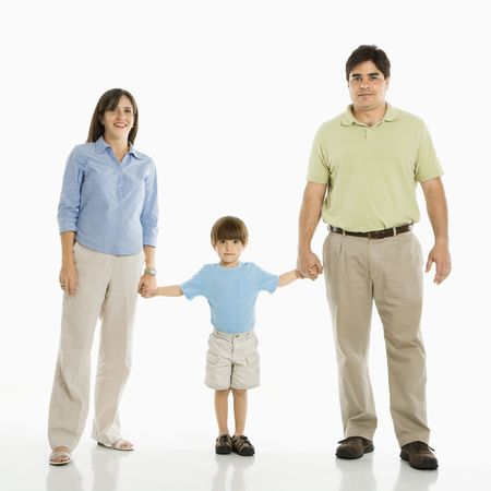Hispanic family of three standing against white background holding hands. Stock Photo - 1874351