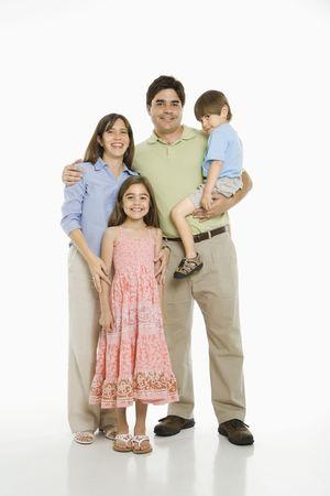 Hispanic family standing against white background. Stock Photo - 1874377