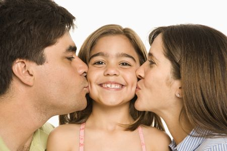 opposite: Mother and father kissing smiling daughter   on opposite cheeks.