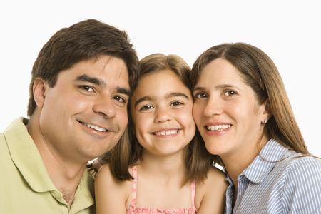 Parents and daughter smiling against white background.
