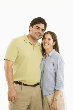 Portrait of smiling couple standing against white background. Stock Photo - 1874598