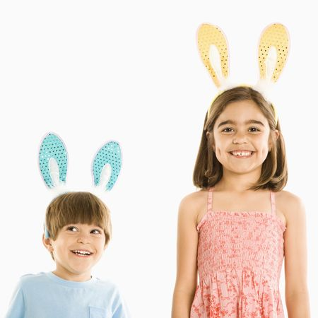 bunny girl: Portrait of boy and girl wearing rabbit ears smiling.