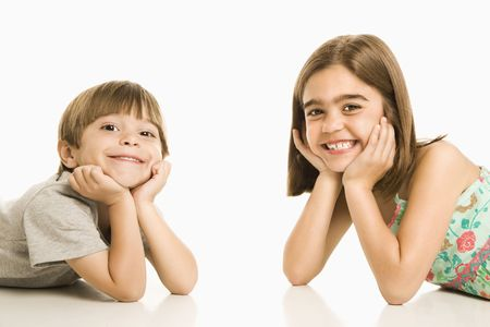 Portrait of girl and boy smiling against white background. Stock Photo - 1874381