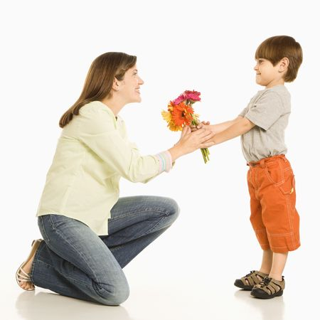 Son giving bouquet of flowers to mother. photo