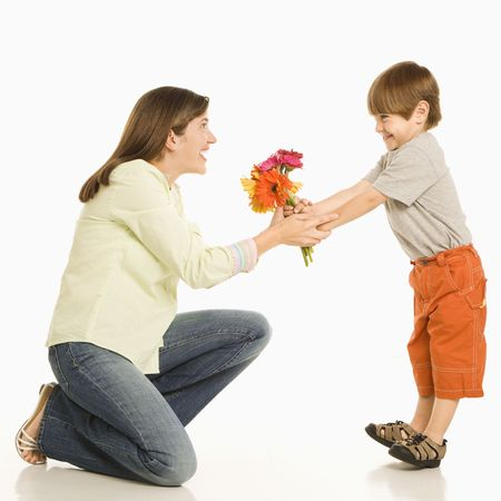 mother day: Son giving bouquet of flowers to mother.