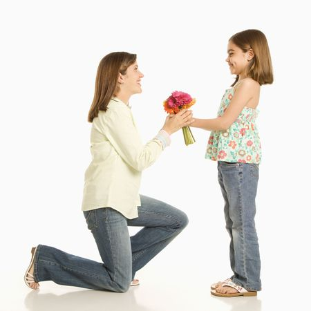 woman profile: Daughter giving bouquet of flowers to mother.
