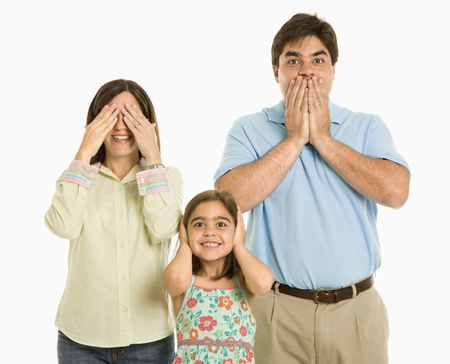 Family doing hear no evil, see no evil, speak no evil gestures. photo