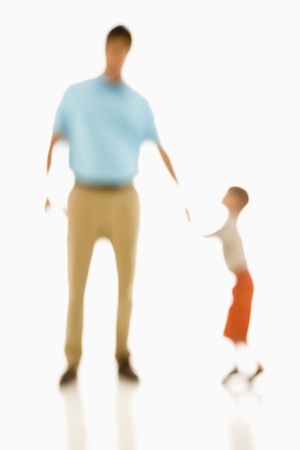 Soft focus father holding sons hand. photo