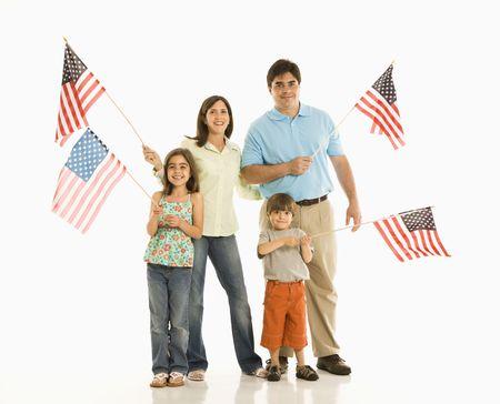 Hispanic family holding American flags. photo