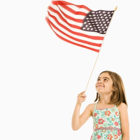 Girl holding American flag against white background. Stock Photo - 1874343