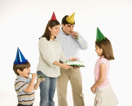 Family celebrating girl's birthday with cake. Stock Photo - 1874479