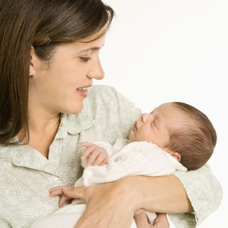 hold: Mother holding baby smiling against white background. Stock Photo