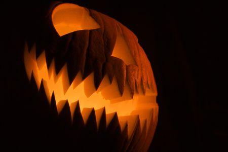 doorstep: Glowing jack-o-lantern. Stock Photo