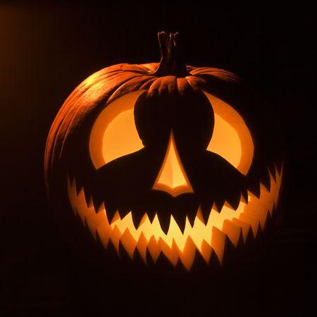 Carved Halloween pumpkin glowing in the dark. Stock Photo - 1906614