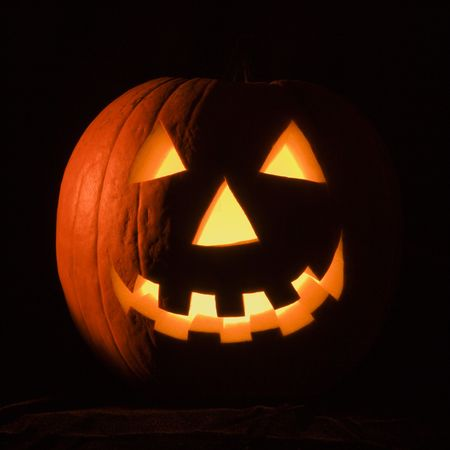 Carved Halloween pumpkin glowing in the dark. Stock Photo - 1906584