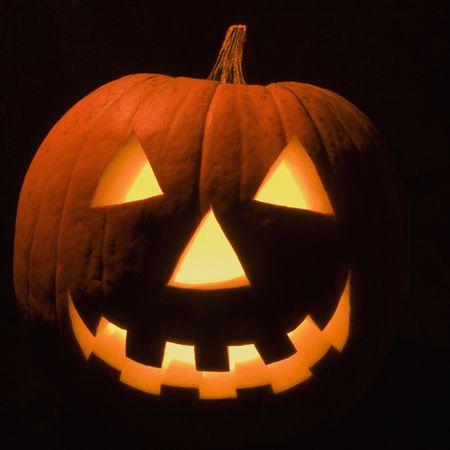 Carved Halloween pumpkin glowing in the dark. Stock Photo - 1906627