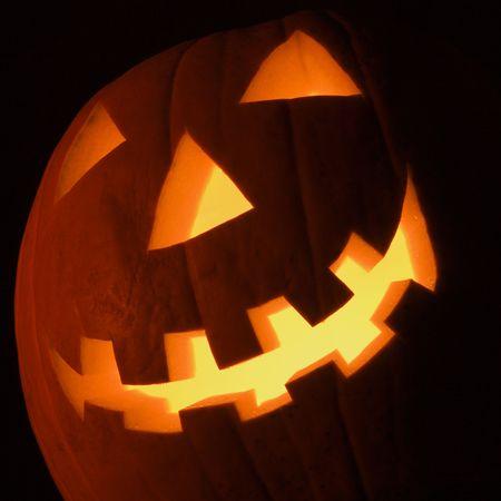 Carved Halloween pumpkin glowing in the dark. Stock Photo - 1906641