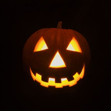 Carved Halloween pumpkin glowing in the dark. Stock Photo - 1906712