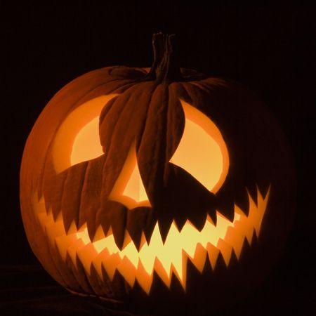 Carved Halloween pumpkin glowing in the dark. Stock Photo - 1906600