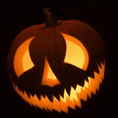 Carved Halloween pumpkin glowing in the dark. Stock Photo - 1906583