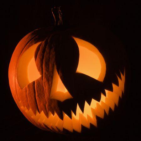 Carved Halloween pumpkin glowing in the dark. Stock Photo - 1906585