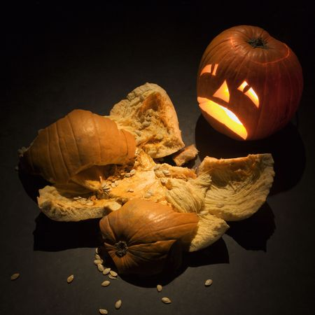 smashed: Upset jack-o-lantern looking at smashed pumpkin.