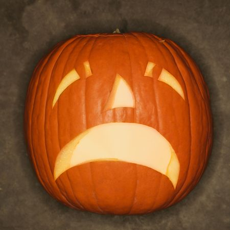 Frowning Halloween jack-o-lantern. photo