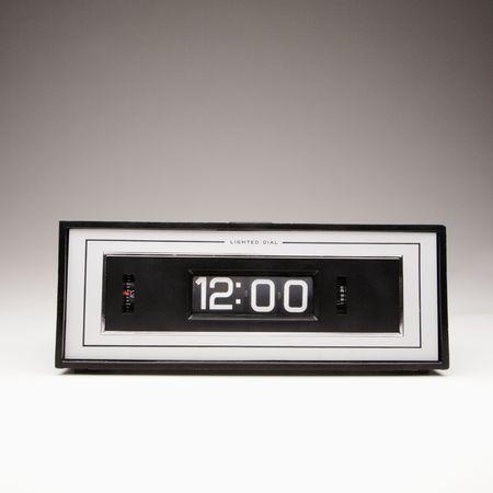 Retro clock set for 12:00. photo