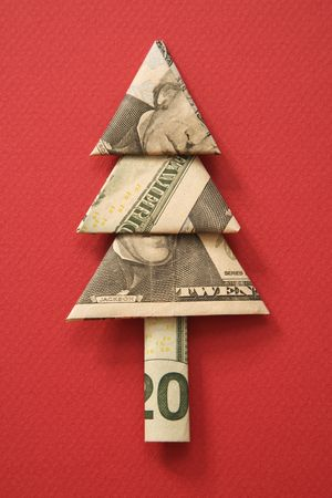 Studio shot of origami tree made from a twenty dollar bill on red background. photo