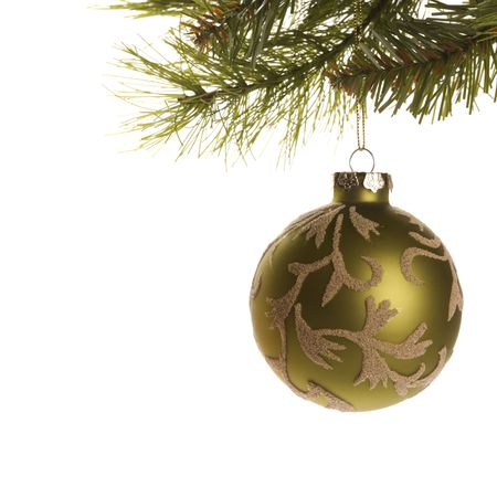 Still life of gold Christmas ornament hanging from pine branch. Stock Photo - 1906752