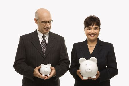 sexes: Caucasian middle-aged businessman and Filipino businesswoman holding different sized piggybanks.