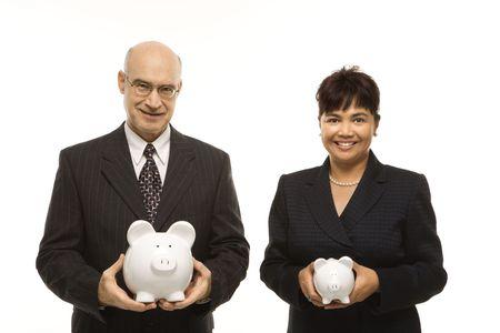 piggybanks: Caucasian middle-aged businessman and Filipino businesswoman holding different sized piggybanks.