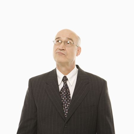 indecisive: Caucasian middle-aged businessman looking indecisive standing against white background.