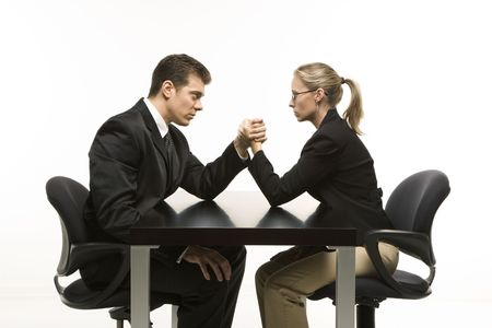 Side view of Caucasian mid-adult businessman and businesswoman arm wrestling on table. Stock Photo - 1991643