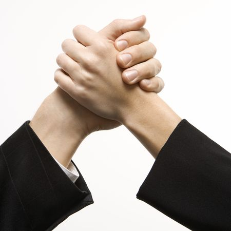 arm: Close-up of hands of Caucasian man and woman arm wrestling. Stock Photo