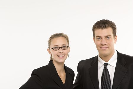 Portrait of Caucasian mid-adult businessman and woman smiling and looking at viewer. photo