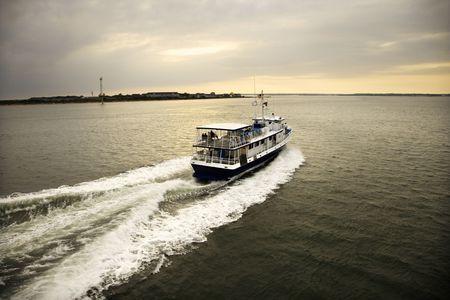 bald head island: Ferry boat transporting passengers across Atlantic Ocean near Bald Head Island, North Carolina. Stock Photo