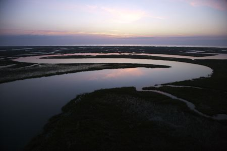bald head: Tidal creek meandering through wetlands of Bald Head Island, North Carolina. Stock Photo