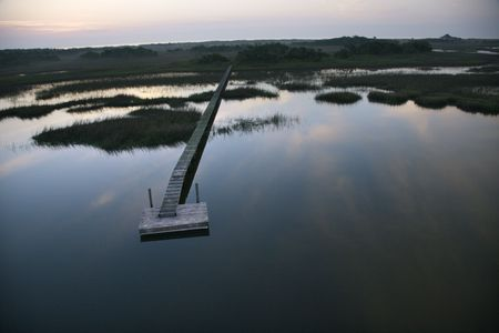 aerial photograph: Aerial view of boat dock and walkway over marsh at Bald Head Island, North Carolina. Stock Photo