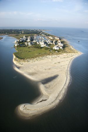 bald head: Aerial view of beach and residential community on Bald Head Island, North Carolina.