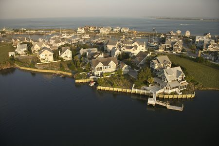 bald head island: Aerial view of houses and ocean at Bald Head Island, North Carolina.