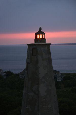 Old Baldy lighthouse at dusk on Bald Head Island, North Carolina.