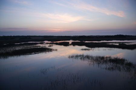 bald head island: Sky reflecting in water in marsh area on Bald Head Island, North Carolina.  Stock Photo