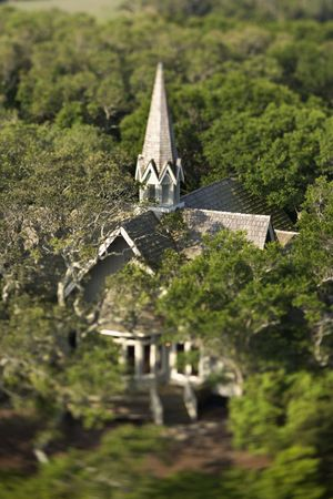 bald head island: Aerial view of church surrounded by trees on Bald Head Island, North Carolina.