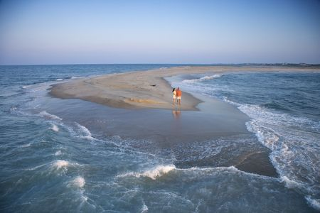sandbar: Birds eye view of couple on sandbar at Bald Head Island, North Carolina during sunrise.
