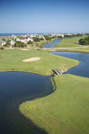 bald head island: Aerial view of golf course in coastal residential community at Bald Head Island, North Carolina.