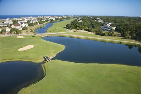 bald head: Aerial view of golf course in coastal residential community at Bald Head Island, North Carolina.
